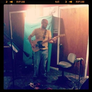 Evan Thompson, playing lead guitar on a tracking session for Parker's Mercy Brigade by Kristen Gilles