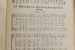 When Poison, Spreading Through Their Veins hymn sheet music from hymnal, photographed by Robert Couse