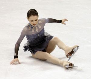 Sasha Cohen slips and falls while performing her free skate routine at the U.S. Figure Skating Championships in Spokane, Wash., Saturday, Jan. 23, 2010. (AP Photo/Rick Bowmer)