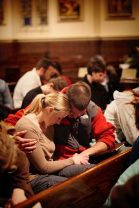 A husband and wife pray together at Sojourn Church vision meeting