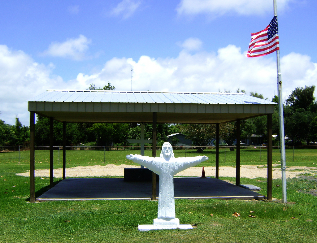 Jesus Statue & American Flag: Should Churches Plan Worship Services To Commemorate Civic Holidays?