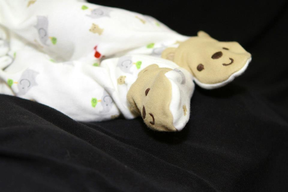 The feet of Parker David Gilles, in his baby bear footies