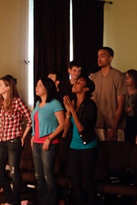 Christian worshipers singing, praising God, raising hands at Sojourn Midtown in Louisville. Photo courtesy Tom Branch