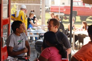 People sharing testimonies and becoming acquainted at Sojourn Church's August 2011 Health Clinic.