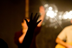 Hand raised in adoration during Christian worship service at Sojourn Community Church