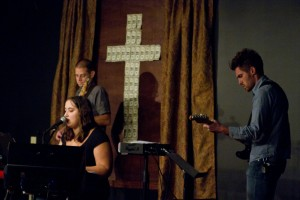 "My ""All I Have Is Yours"" cowriter Rebecca Elliot w/ Sojourn band. ""God Gave"" liturgical art in background"
