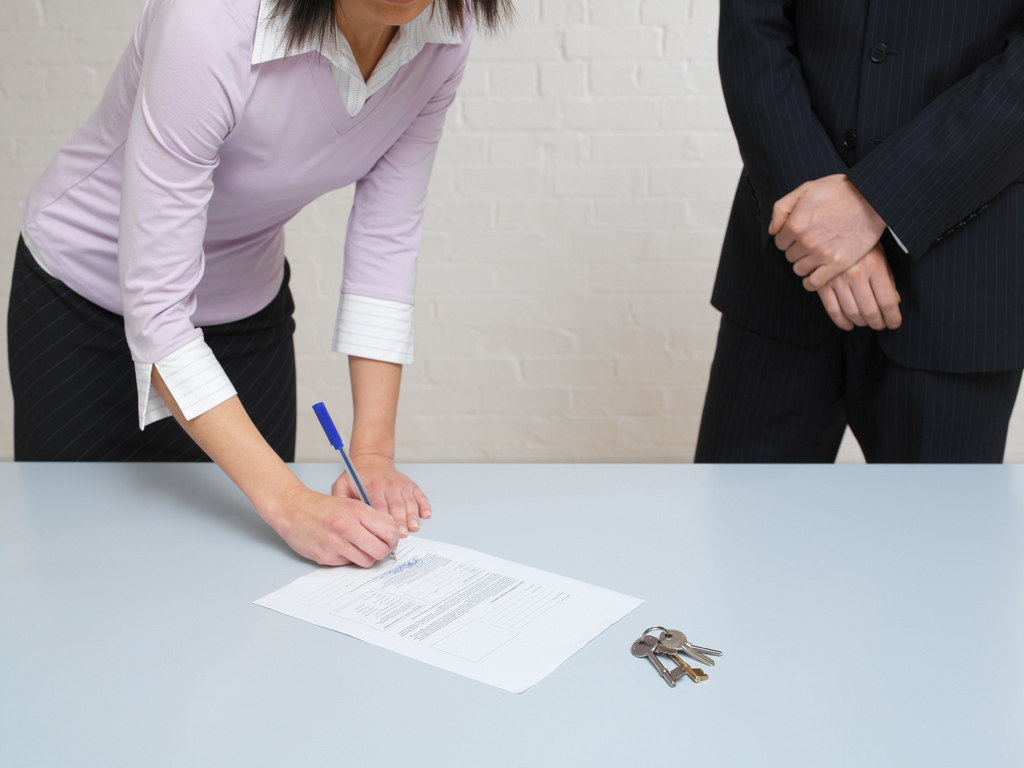 Woman signing contract illustrates the agreement that writers implicitly enter into with singers and listeners to maintain metrical consistency throughout their song.
