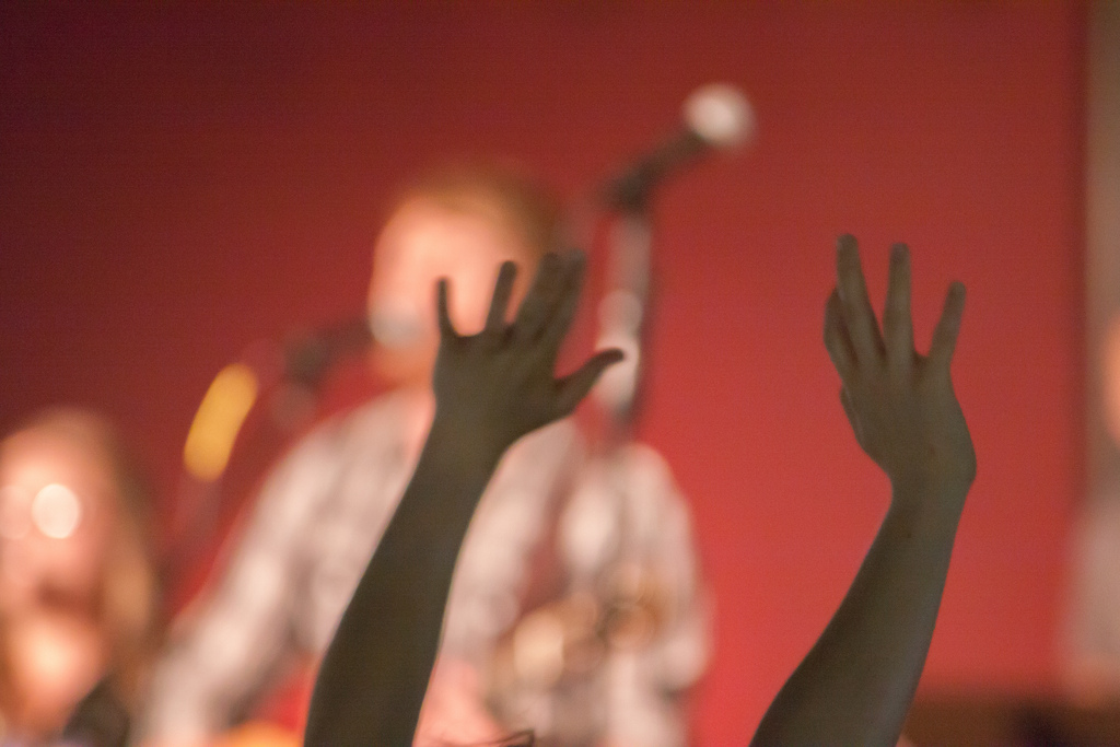 Hands raised in Christian worship service at Sojourn Community Church in Louisville