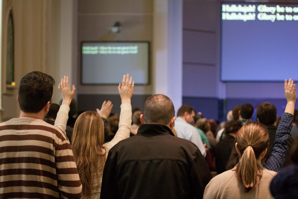 Hands raised in Christian worship service at Sojourn Community Church