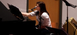 Kristen Gilles arranging music at the piano at Sojourn J-Town. Photo by Tom Branch