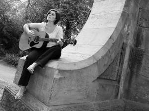 Kristen Gilles playing guitar outdoors