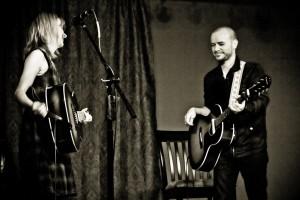 Sandra McCracken and Derek Webb performing at Sojourn's The 930 Art Center.