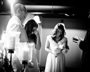 Laughter on stage during wedding ceremony of Bobby and Kristen Gilles, officiated by Pastor Mike Cosper