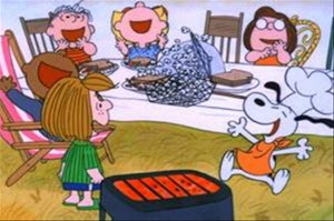 Charlie Brown Thanksgiving screen shot - Peanuts gang laughing around the table
