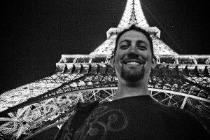 """Sojourn's 6'6"""" inch Pastor Daniel Wainright doesn't look so tall next to the Eiffel Tower, on this European mission trip"""