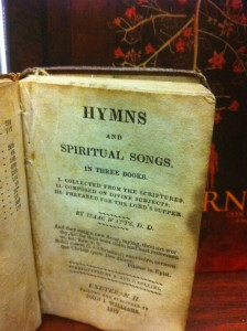 1822 Edition of Isaac Watts Hymnal along with CD cover of Sojourn's Over The Grave: The Hymns of Isaac Watts, Volume One