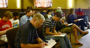 Writers work at a songwriting workshop at our church, Sojourn